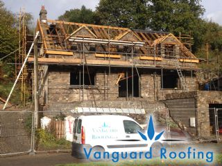 A new timber cut roof construction in progess with dormers