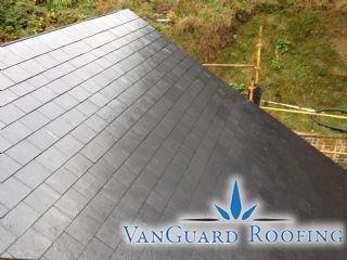 Another of this roofs several pitches has been completely covered  It is apparent how beautiful a finished natural slate roof can look