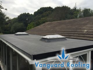 Completed flat roof conversion with roof domes