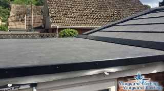 Flat roof to a conservatory abutment